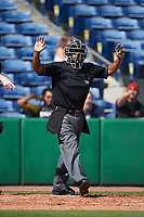 Home plate umpire Casey Sanchez signals for time during a game between the Alabama State Hornets and Maryland Terrapins on February 19, 2017 at Spectrum Field in Clearwater, Florida.  Maryland defeated Alabama State 9-7.  (Mike Janes/Four Seam Images)