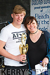 "Fleadh By The Feale Junior Bones Competition held Sunday afternoon Winner John Forde from Ballaugh Abbeyfeale receiving his trophy from ""Dervish"" member Kathy Jordan."