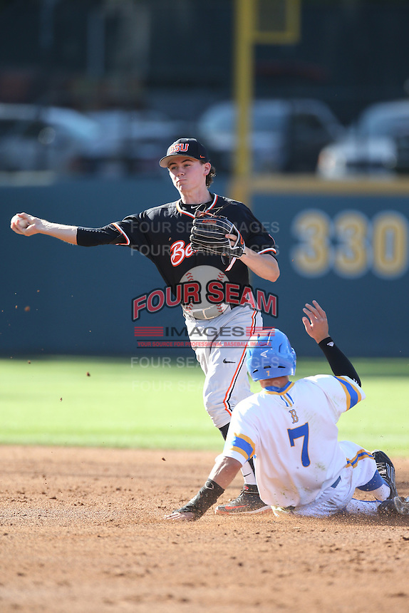 Trever Morrison (7) of the Oregon State Beavers throws to first base after forcing out Kevin Kramer (7) of the UCLA Bruins at second base during a game at Jackie Robinson Stadium on April 4, 2015 in Los Angeles, California. UCLA defeated Oregon State, 10-5. (Larry Goren/Four Seam Images)