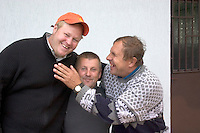 Three friends laughing together at store in Poland.  Sadykierz  Poland