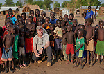 Fr. Tony O'Riordan, SJ, poses with children in the Doro Refugee Camp in Maban, South Sudan. O'Riordan is director of Jesuit Refugee Service in the camp, one of four camps in Maban that together shelter more than 130,000 refugees from the Blue Nile region of Sudan.<br /> <br /> Misean Cara supports the work of JRS in the Maban camps.