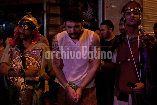 Dwellers of Rocinha slum in Rio de Janeiro perform a theater play resembling in the Way of Christ during Easter in Rio de Janeiro, Brazil