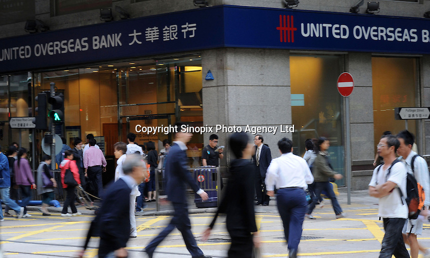 Pedestrians across the street where can see a United Overseas Bank (UOB) situated at the corner, Hong Kong, China. UOB has grown with Singapore over the past 73 years, is a leading bank in Singapore. Today, it has a network of over 500 offices in 18 countries and provides a wide range of financial services through its global network of branches and associates. In Hong Kong, UOB has six branches across the territory with a staff strength of more than 200..
