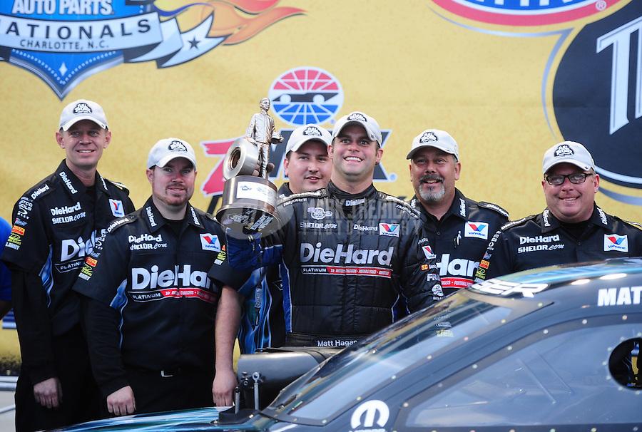 Sept. 18, 2011; Concord, NC, USA: NHRA funny car driver Matt Hagan celebrates with his crew after winning the O'Reilly Auto Parts Nationals at zMax Dragway. Mandatory Credit: Mark J. Rebilas-