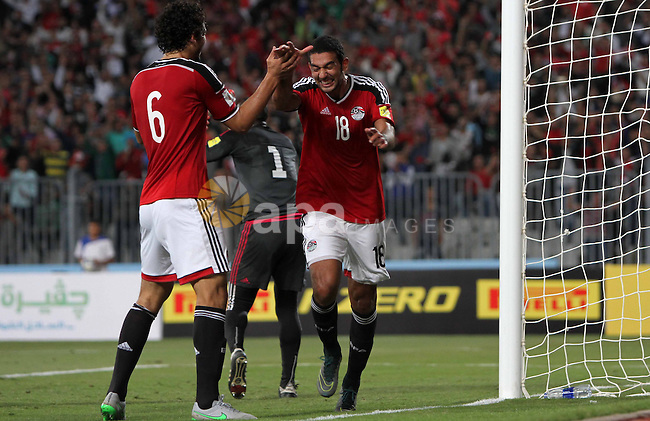 """Egypt's players celebrate after Ahmed Hassan """"Koka"""" scored a goal during their 2018 World Cup qualifying soccer match against Chad at Borg El Arab """"Army Stadium"""" in the Mediterranean city of Alexandria, north of Cairo, Egypt, November 17, 2015. Spectators will be watching the match after receiving approval from security for the first time in a long time. Photo by Amr Sayed"""