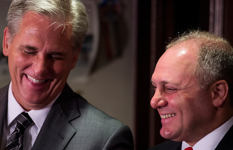UNITED STATES - JUNE 24: Majority-Leader-elect Kevin McCarthy, R-Calif., left, and Majority-Whip-elect Steve Scalise, R-La., talk during the press conference at the Republican National Committee following the House Republican Conference meeting on Tuesday, June 24, 2014. (Photo By Bill Clark/CQ Roll Call)