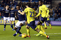 Mahlon Romeo of Millwall and Lewis Travis of Blackburn Rovers during Millwall vs Blackburn Rovers, Sky Bet EFL Championship Football at The Den on 12th January 2019