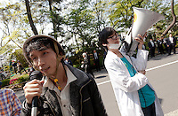 Yuhimaru Takeda (left) and Makoto Masu (right) iprotesting at a Zengakuren student union demo at Hosei University Campus. Ichigaya, Tokyo, Japan. Friday April 25th 2014