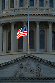 The flag over the Capitol flies at half-staff before the arrival of the casket of former President George. H. W. Bush at the Capitol Rotunda in Washington, DC where he will lie state, December 3, 2018. Credit: Chris Kleponis / CNP