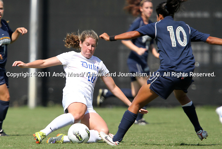 11 September 2011: Duke's Nicole Lipp (left) is defended by UNCG's Karina Rodrigues (right). The Duke University Blue Devils defeated the University of North Carolina at Greensboro Spartans 2-0 at Koskinen Stadium in Durham, North Carolina in an NCAA Division I Women's Soccer game.