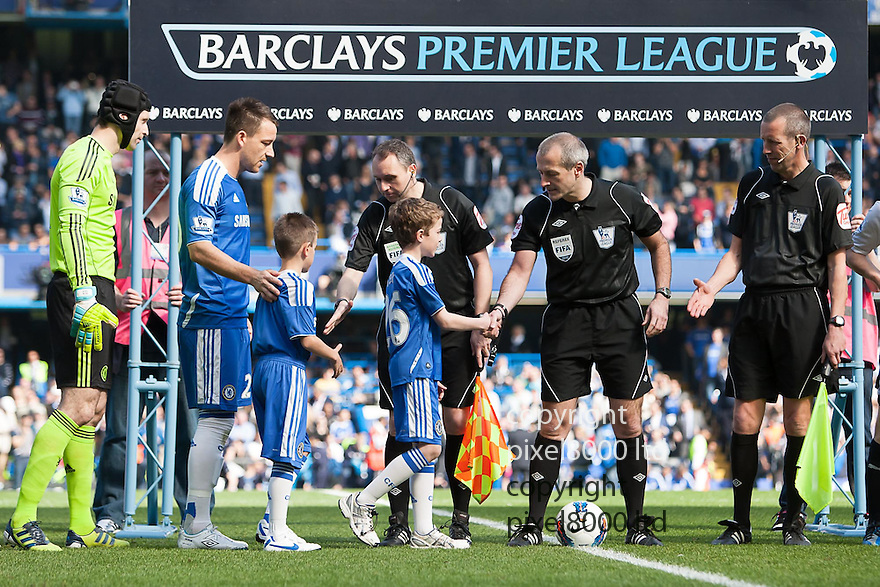 London, UK. Chelsea captain John Terry leads out his side ahead of Barclays Premier League fixture Chelsea versus Tottenham Hotspur at Stamford Bridge 24 Mar.  Byline David Fearn Pixel 8000 Ltd