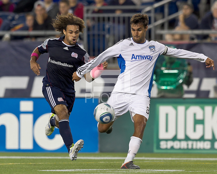 San Jose Earthquakes forward Chris Wondolowski (8) passes as New England Revolution defender Kevin Alston (30) closes. In a Major League Soccer (MLS) match, the San Jose Earthquakes defeated the New England Revolution, 2-1, at Gillette Stadium on October 8, 2011.