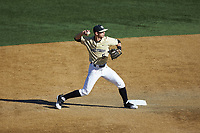 Wake Forest Demon Deacons shortstop Patrick Frick (5) makes a throw to first base against the Gardner-Webb Runnin' Bulldogs at David F. Couch Ballpark on February 18, 2018 in  Winston-Salem, North Carolina. The Demon Deacons defeated the Runnin' Bulldogs 8-4 in game one of a double-header.  (Brian Westerholt/Four Seam Images)