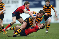 4 March 2013; RBAI centre Rory Bell is tackled by Ballyclare centreEddie McKee and out half Jack Irvine during the schools cup semi-final clash between RBAI and Ballyclare High School at Ravenhill Belfast. Photo Credit : John Dickson / DICKSONDIGITAL