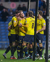 Teammates celebrate with goal scorer Kemar Roofe of Oxford United during the Sky Bet League 2 match between Oxford United and Bristol Rovers at the Kassam Stadium, Oxford, England on 17 January 2016. Photo by Andy Rowland / PRiME Media Images.