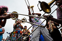 Brass players of the Orquestra Voadora band perform during the carnival street party in Flamengo, Rio de Janeiro, Brazil, 21 February 2012. Most of the carnival street parties in Rio are organized and run by Blocos. Each Bloco consists of a musical band and a group of partygoers. The Blocos, closely linked to the neighborhoods they come from, start their free-to-join parades early in January and continue throughout the carnival season. Playing usually their own samba song, backed up with a numerous bateria (drum and percussion players), Blocos are considered the beating heart of the Rio Carnival.
