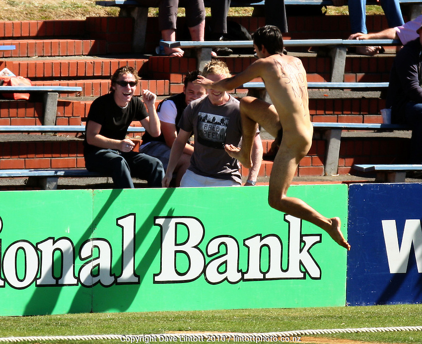 A streaker leaps the boundary fence to make his escape. 1st cricket test match - New Zealand Black Caps v Australia, day one at the Basin Reserve, Wellington.Friday, 19 March 2010. Photo: Dave Lintott / lintottphoto.co.nz