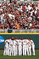 Mississippi State Bulldogs huddle before Game 1 of the 2013 Men's College World Series Finals against the UCLA Bruins on June 24, 2013 at TD Ameritrade Park in Omaha, Nebraska. The Bruins defeated the Bulldogs 3-1, taking a 1-0 lead in the best of 3 series. (Andrew Woolley/Four Seam Images)