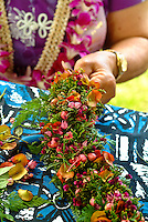 Weaving a lei po'o (head lei at a craft fair on Lei Day in Waikiki, island of Oahu