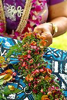 Weaving a lei po'o (head lei at a craft fair on Lei Day in Waikiki, island of Oahu