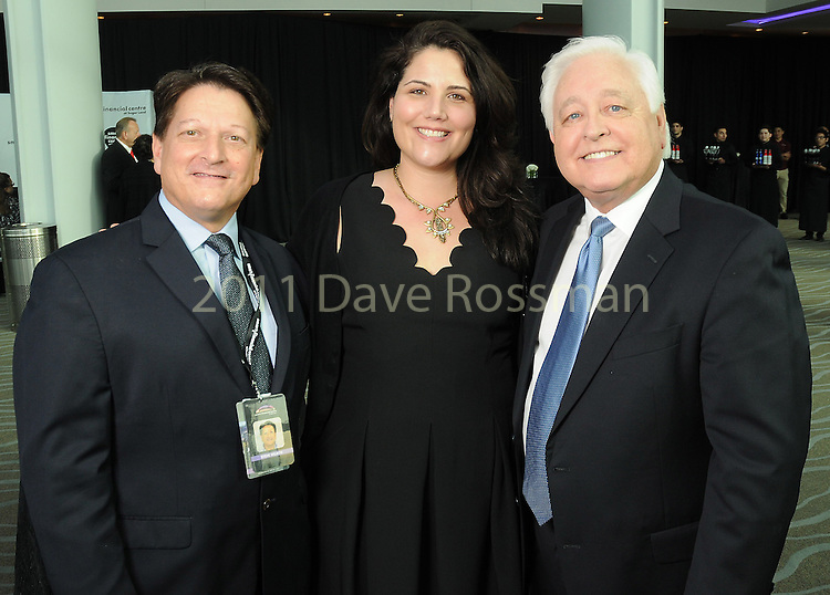 From left: Steve Wilson, Emily Smith and David Skinner at the grand-opening reception at the Smart Financial Centre in Sugar Land Saturday Jan. 14, 2017.(Dave Rossman photo)