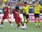 Football: Test Match, Liverpool FC - Borussia Dortmund. Liverpool midfielder Yasser Larouci (65, left) and Borussia Dortmund midfielder Jadon Sancho (7) vie for the ball in their exhibition match on July 19, 2019 at Notre Dame Stadium. <br /> Tim Vizer/DPA