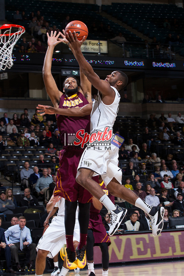 Codi Miller-McIntyre (0) of the Wake Forest Demon Deacons drives to the basket past Maurice Walker (15) of the Minnesota Golden Gophers during first half action at the LJVM Coliseum on December 2, 2014 in Winston-Salem, North Carolina.  The Golden Gophers defeated the Demon Deacons 84-69. (Brian Westerholt/Sports On Film)