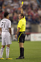 Terry Vaughn issues yellow card warning to DC United forward Pablo Hernandez (21). The New England Revolution defeated DC United, 1-0, at Gillette Stadium on August 7, 2010.