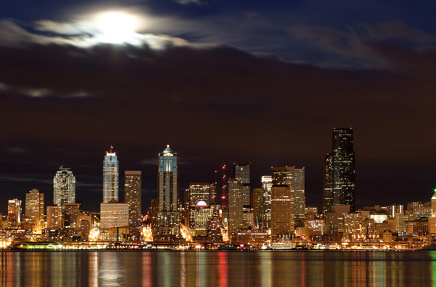 Seattle skyline and full moon reflecting in Elliot Bay viewed from West Seattle, Seattle, Washington, USA
