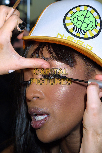 NAOMI CAMPBELL.backstage at Victoria's Secret Fashion Show.www.capitalpictures.com.sales@capitalpictures.com.©Capital Pictures.applying makeup, applying mascara