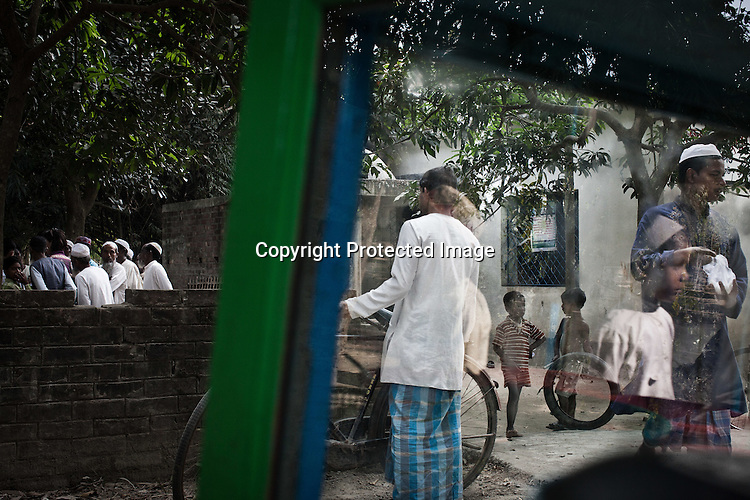 Muslims from the Chowduli class seen coming out of the mosque after the friday prayers in Chaymalpur village of North 24 Parganas in West Bengal, India. Photo: Sanjit Das/Panos for The Wall Street Journal. Slug: ICASTE