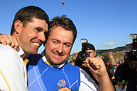 Graeme McDowell celebrates with Padraig Harrington on the 18th after he sunk the winning putt to win the ryder cup 14.5 to 13.5 on the 17th at the 2010 Ryder Cup at the Celtic Manor twenty ten course, Newport Wales, 4/10/2010.Picture Fran Caffrey/www.golffile.ie.