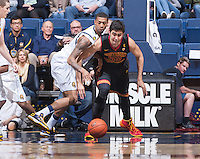 California's Richard Solomon fights for the ball away from USC's Omar Oraby during a game at Haas Pavilion in Berkeley, California on February 23th, 2014. California defeated USC 77 - 64