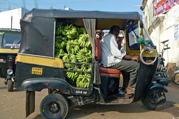 Indian tuktuk (autorikshaw) with a load of bananas at Mysore market, Mysore, Karnataka, India.
