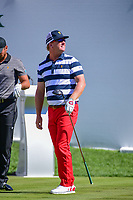 Charley Hoffman (USA) looks to the international crowd after his tee shot on 1 during round 4 Singles of the 2017 President's Cup, Liberty National Golf Club, Jersey City, New Jersey, USA. 10/1/2017. <br /> Picture: Golffile | Ken Murray<br /> <br /> All photo usage must carry mandatory copyright credit (&copy; Golffile | Ken Murray)