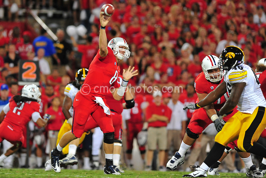 Sept 18, 2010; Tucson, AZ, USA; Arizona Wildcats quarterback Nick Foles (8) throws a pass in the 1st quarter of a game against the Iowa Hawkeyes at Arizona Stadium.