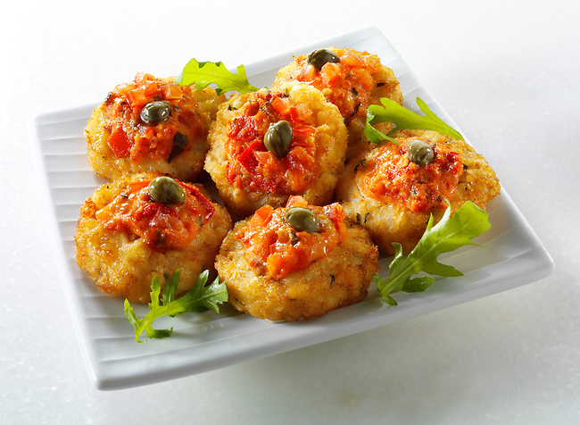 Mini potato rosti topped with tomato salsa and capers
