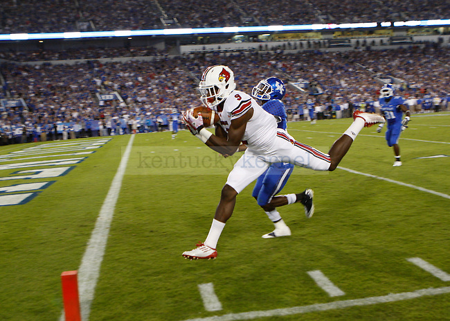 UL wide receiver DeVante Parker catches a pass for a touchdown during the first half of UK's home game against Louisville, Saturday, Sept. 17, 2011 in Lexington, Ky.  Photo by Brandon Goodwin | Staff