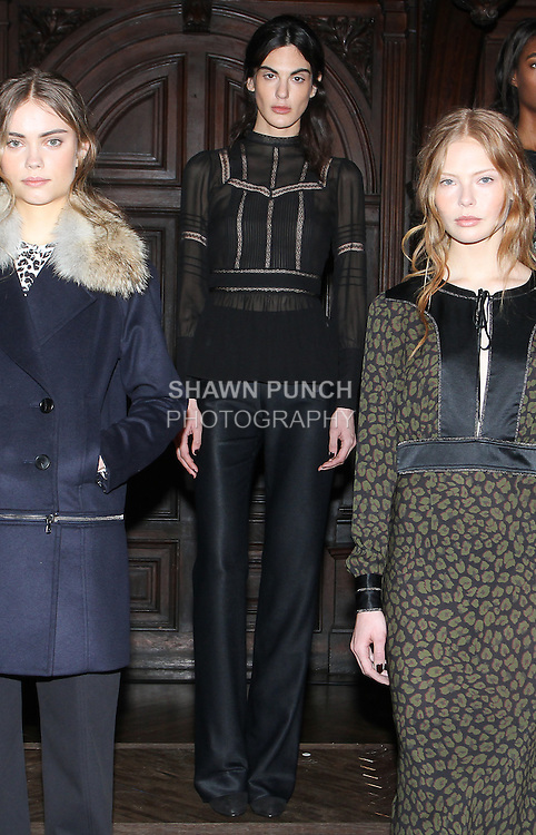 """Model Persina poses in a black washed lace inset Victorian blouse, and black stretch satin twill tapered trouser, from the Veronica Beard Fall 2016 """"Gypsy Caravan"""" collection presentation, at the Highline Hotel on February 15 2016, during New York Fashion Week Fall 2016."""