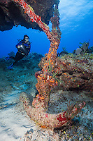 TR5831-D. Scuba diver (model released) admires large historical Spanish anchor from 1872 at the dive site called Snapper Hole on the east end of Grand Cayman. Cayman Islands, Caribbean Sea.<br /> Photo Copyright &copy; Brandon Cole. All rights reserved worldwide.  www.brandoncole.com