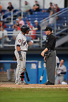 Mahoning Valley Scrappers catcher Gian Paul Gonzalez (4) argues with home plate umpire Evin Johnson during a game against the Batavia Muckdogs on August 16, 2017 at Dwyer Stadium in Batavia, New York.  Batavia defeated Mahoning Valley 10-6.  (Mike Janes/Four Seam Images)