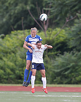 Boston Breakers defender Julie King (8) and Sky Blue FC forward Lisa De Vanna (11) battle for head ball.  In a National Women's Soccer League Elite (NWSL) match, Sky Blue FC (white) defeated the Boston Breakers (blue), 3-2, at Dilboy Stadium on June 16, 2013.