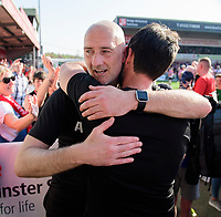 Lincoln City's first team goalkeeping coach Andy Warrington, left, hugs Lincoln City manager Danny Cowley celebrate after winning the league<br /> <br /> Photographer Chris Vaughan/CameraSport<br /> <br /> The EFL Sky Bet League Two - Lincoln City v Tranmere Rovers - Monday 22nd April 2019 - Sincil Bank - Lincoln<br /> <br /> World Copyright © 2019 CameraSport. All rights reserved. 43 Linden Ave. Countesthorpe. Leicester. England. LE8 5PG - Tel: +44 (0) 116 277 4147 - admin@camerasport.com - www.camerasport.com