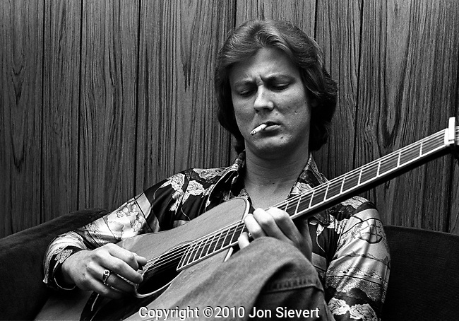 Tony Rice, backstage at GAMH, SF.May 27, 1977, 28-20-4A. Acoustic guitarist and bluegrass musician. Rice is considered as one of the greatest and most influential acoustic guitar players of all time, particularly in bluegrass, progressive bluegrass, newgrass and acoustic jazz.<br /> <br /> Rice spans the range of acoustic music, from traditional bluegrass to jazz-influenced &quot;Spacegrass&quot; music, to songwriter-oriented folk. Over the course of his career, he has played alongside J. D. Crowe and the New South, David Grisman (during the formation of &quot;Dawg Music&quot;) and Jerry Garcia, led his own Tony Rice Unit, collaborated with Norman Blake, recorded with his brothers Wyatt, Ron and Larry and co-founded the Bluegrass Album Band. He has recorded with drums, piano, soprano sax, as well as with traditional Bluegrass instrumentation.