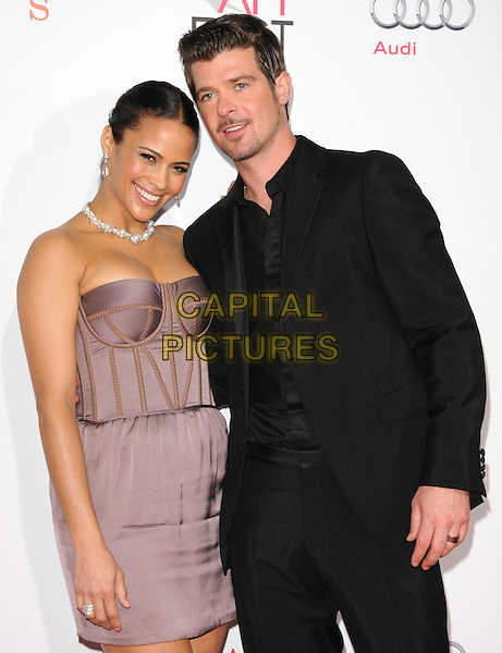 "PAULA PATTON & ROBIN THICKE .The 2009 AFI Fest Screening of ""Precious"" held at The Grauman's Chinese Theatre in Hollywood, California, USA..November 1st, 2009.half length purple grey gray corset strapless mini dress  married husband wife black suit diamond necklace stubble goatee facial hair  .CAP/RKE/DVS.©DVS/RockinExposures/Capital Pictures"