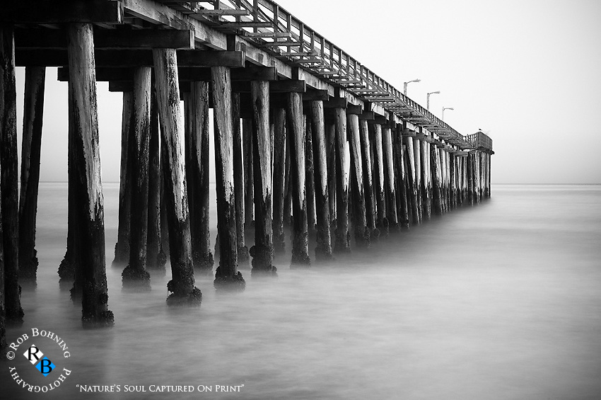 A slow exposure here yields an almost cotton-like tranquility of the water moving in under the Cayucos Pier