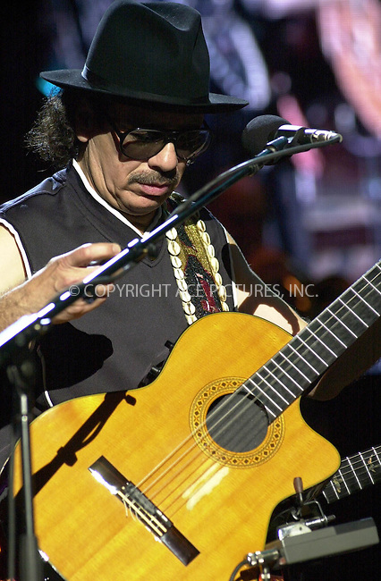 Santana in concert at Jones Beach. New York. August 9,    2002. Please byline: ARTHUR J./ACEPIXS.COM   .. *** ***  ..Ace Pictures, Inc:  ..contact: Alecsey Boldeskul (646) 267-6913 ..Philip Vaughan (646) 769-0430..e-mail: info@acepixs.com