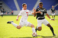 Buck Tufty (10) of the Louisville Cardinals is defended by George Hodge (3) of the Providence Friars. The Louisville Cardinals defeated the Providence Friars 3-2 in penalty kicks after playing to a 1-1 tie during the finals of the Big East Men's Soccer Championship at Red Bull Arena in Harrison, NJ, on November 14, 2010.