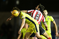 Lincoln City's Ollie Palmer vies for possession with Cheltenham Town's William Boyle<br /> <br /> Photographer Chris Vaughan/CameraSport<br /> <br /> The EFL Sky Bet League Two - Lincoln City v Cheltenham Town - Tuesday 13th February 2018 - Sincil Bank - Lincoln<br /> <br /> World Copyright &copy; 2018 CameraSport. All rights reserved. 43 Linden Ave. Countesthorpe. Leicester. England. LE8 5PG - Tel: +44 (0) 116 277 4147 - admin@camerasport.com - www.camerasport.com