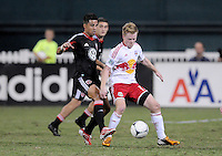 New York Red Bulls midfielder Dax McCarty shields the ball from D.C. United midfielder Marcelo Saragosa (11) The New York Red Bulls tied D.C. United 2-2 at RFK Stadium, Wednesday August 29, 2012.